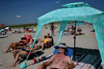 Todd Zuzulo relaxed at the Good Harbor Beach in Gloucester in July.CRAIG F. WALKER/GLOBE STAFF