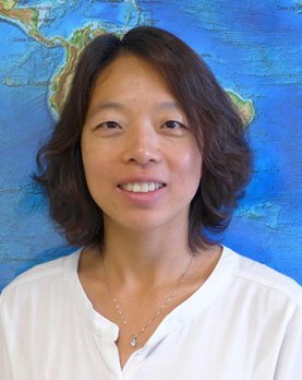 Portrait of Dr. Haiying Gao in front of World Tectonic Map