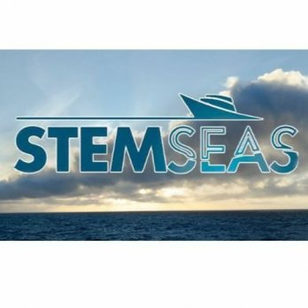 STEMSEAS logo in front of flat, dark blue ocean and white clouds in blue sky near sunset