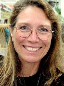Portrait of Dr. Julie Brigham-Grette, smiling at camera