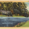 Vintage color postcard of Forest Park in Springfield, MA, showing watercourse flanked by mown turf and verdant deciduous trees. Image Source: Boston Public Library Fickr account