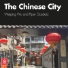 "Book Cover for ""The Chinese City"" feturing title in white san-serif text over photograph of stone-paved courtyard festively hung with red, oblate, paper lanterns."