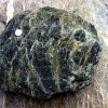 Photo of boulder of Serpentinite from French Alps.  photo by Gabriel HM