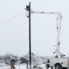 Linemen work to restore power in Texas during winter storm, February 2021. Photo by Jonathan Cutrer, via Flickr [CC BY-NC 2.0]